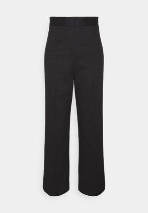 CRETA - Trousers - black
