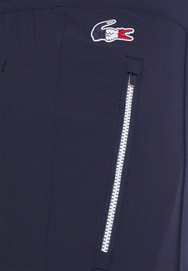 OLYMP PANT - Tracksuit bottoms - navy blue/white