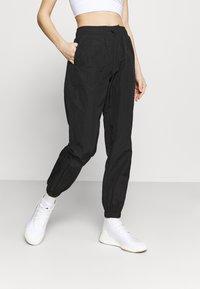 Hunkemöller - MALILA TRACK PANT - Pantalones deportivos - black - 0