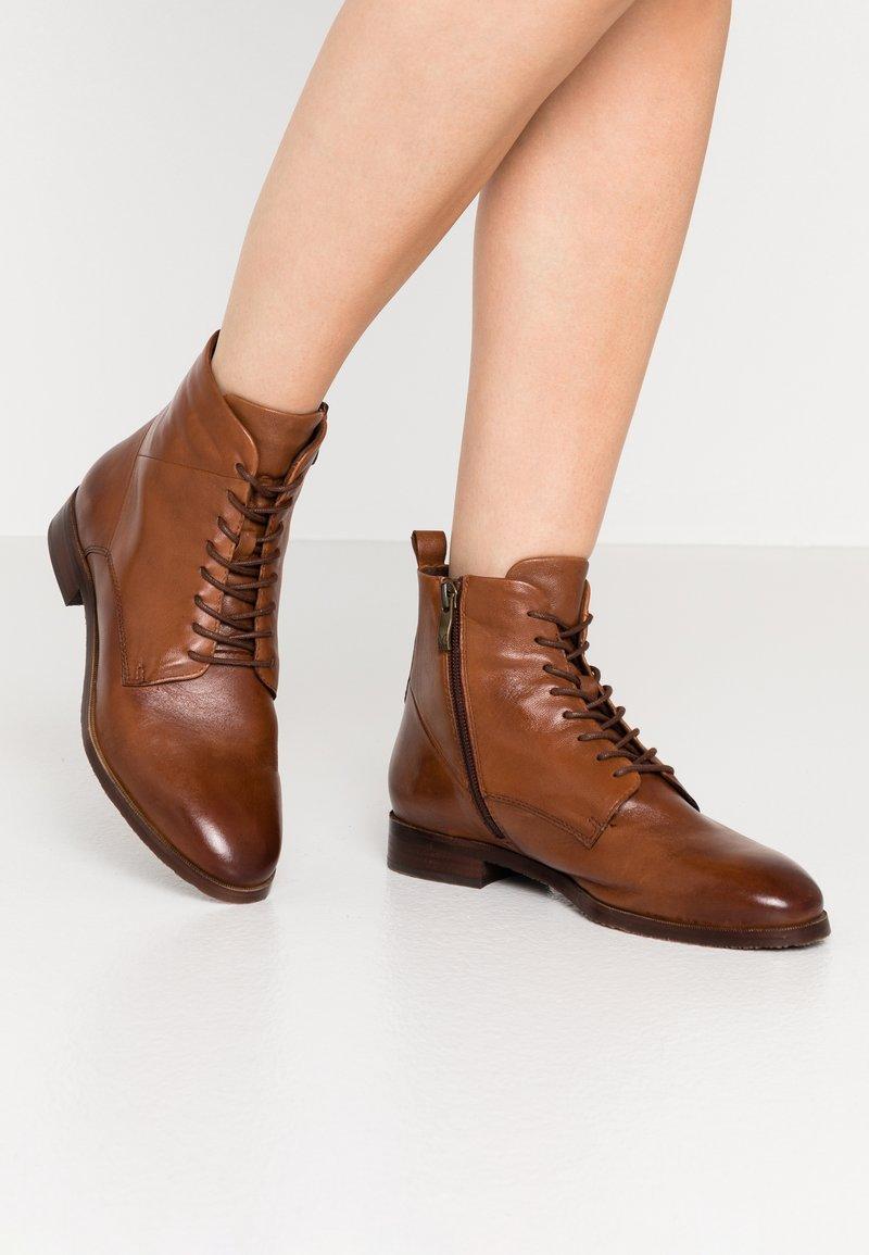Caprice - Lace-up ankle boots - cognac