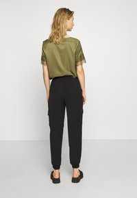 ONLY - ONLNEVIE SONJA LIFE  STRING PANT - Trousers - black - 2