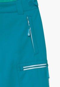 TrollKids - KIDS HALLINGDAL - Snow pants - light petrol/dark mint - 4