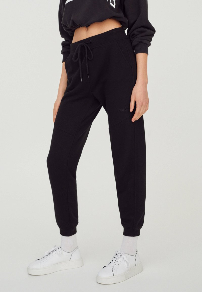 PULL&BEAR - Tracksuit bottoms - black