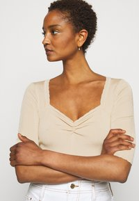 Claudie Pierlot - MINILI - Jednoduché triko - beige - 3