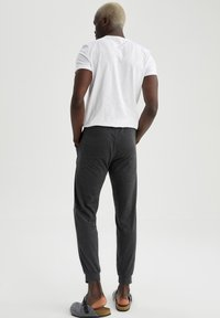 DeFacto - Tracksuit bottoms - anthracite - 2