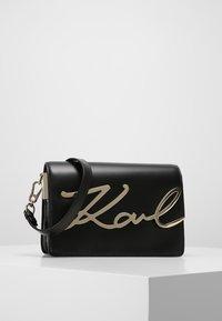 KARL LAGERFELD - SIGNATURE - Across body bag - black - 0