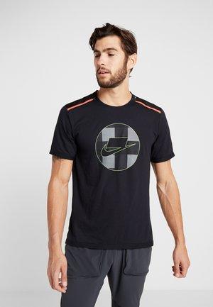 WILD RUN - Print T-shirt - black