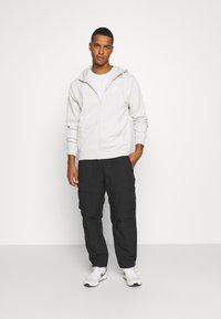 Nike Sportswear - Trousers - black - 1