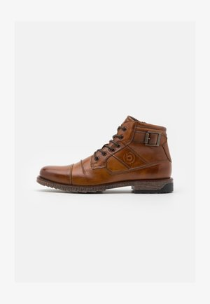 SATURINO - Bottines à lacets - cognac