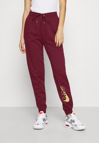 Nike Sportswear - PANT - Tracksuit bottoms - dark beetroot/metallic gold - 0