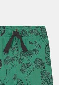 Mini Rodini - TIGERS UNISEX - Trousers - green - 2