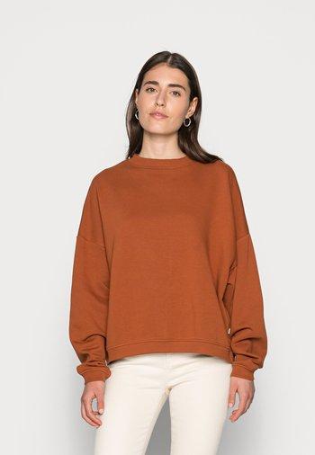 Collegepaita - rust orange