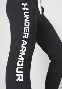 Under Armour - RIVAL SHINE JOGGER - Tracksuit bottoms - black - 3