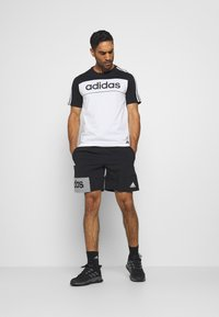 adidas Performance - AEROREADY TRAINING SHORTS - Short de sport - black/white
