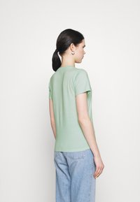 Hollister Co. - TECH CORE - Print T-shirt - light green - 2