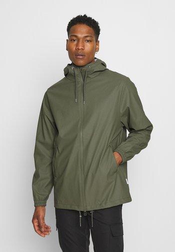STORM BREAKER UNISEX - Waterproof jacket - olive