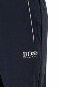 BOSS - Tracksuit bottoms - dark blue - 5