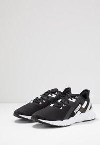 Puma - WEAVE XT - Stabilty running shoes - black/white - 2