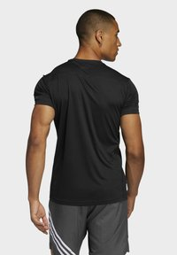 adidas Performance - RESPONSE AEROREADY RUNNING SHORT SLEEVE TEE - T-shirt imprimé - black - 4