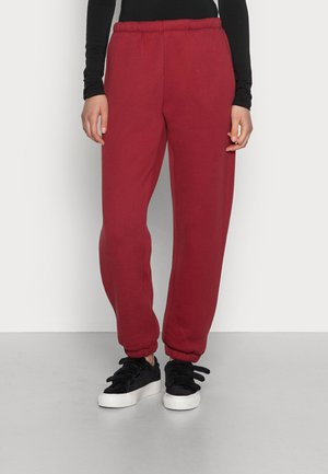 IKATOWN - Tracksuit bottoms - berry
