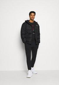 Fila - LASSE PUFFED JACKET - Winter jacket - black - 1