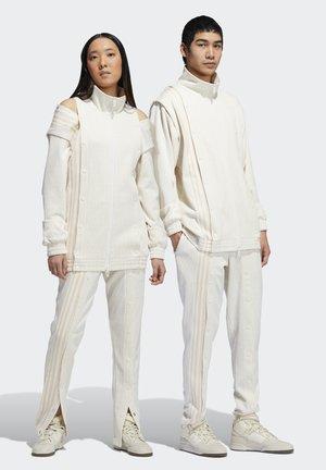 IVY PARK MONOGRAM TRACK PANTS (ALL GENDER) - Tracksuit bottoms - core white
