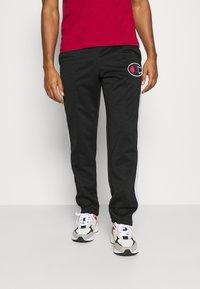 Champion - STRAIGHT PANTS - Tracksuit bottoms - black - 0