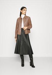 Sisley - Leather jacket - brown - 1