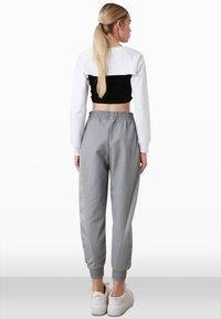 Trendyol - Tracksuit bottoms - grey - 2