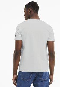 Puma - ATHLETICS  - T-shirt con stampa - vaporous gray - 2