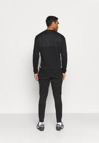 New Balance - AS ROMA - Club wear - black - 2