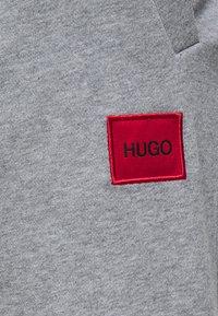 HUGO - DOAK - Tracksuit bottoms - silver - 5