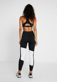 Puma - LOGO GRAPHIC  - Leggings - puma black/puma white - 2
