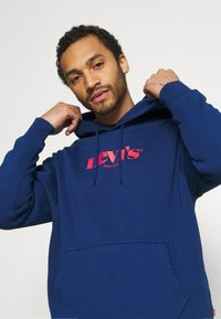 Levi's® - PEANUTS RELAXD GRAPHIC HOODIE - Jersey con capucha - blues - 3