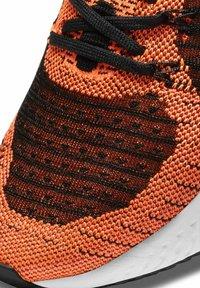 Nike Performance - REACT INFINITY RUN FK 2 - Neutral running shoes - bright mango black white - 5