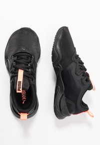 Puma - ZONE XT PEARL - Sports shoes - black/energy peach - 1