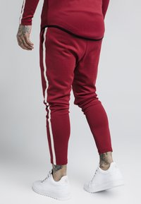 SIKSILK - TECH ATHLETE TRACK PANTS - Tracksuit bottoms - burgundy - 2