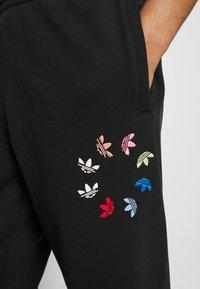 adidas Originals - PANT - Tracksuit bottoms - black/multicolor - 3