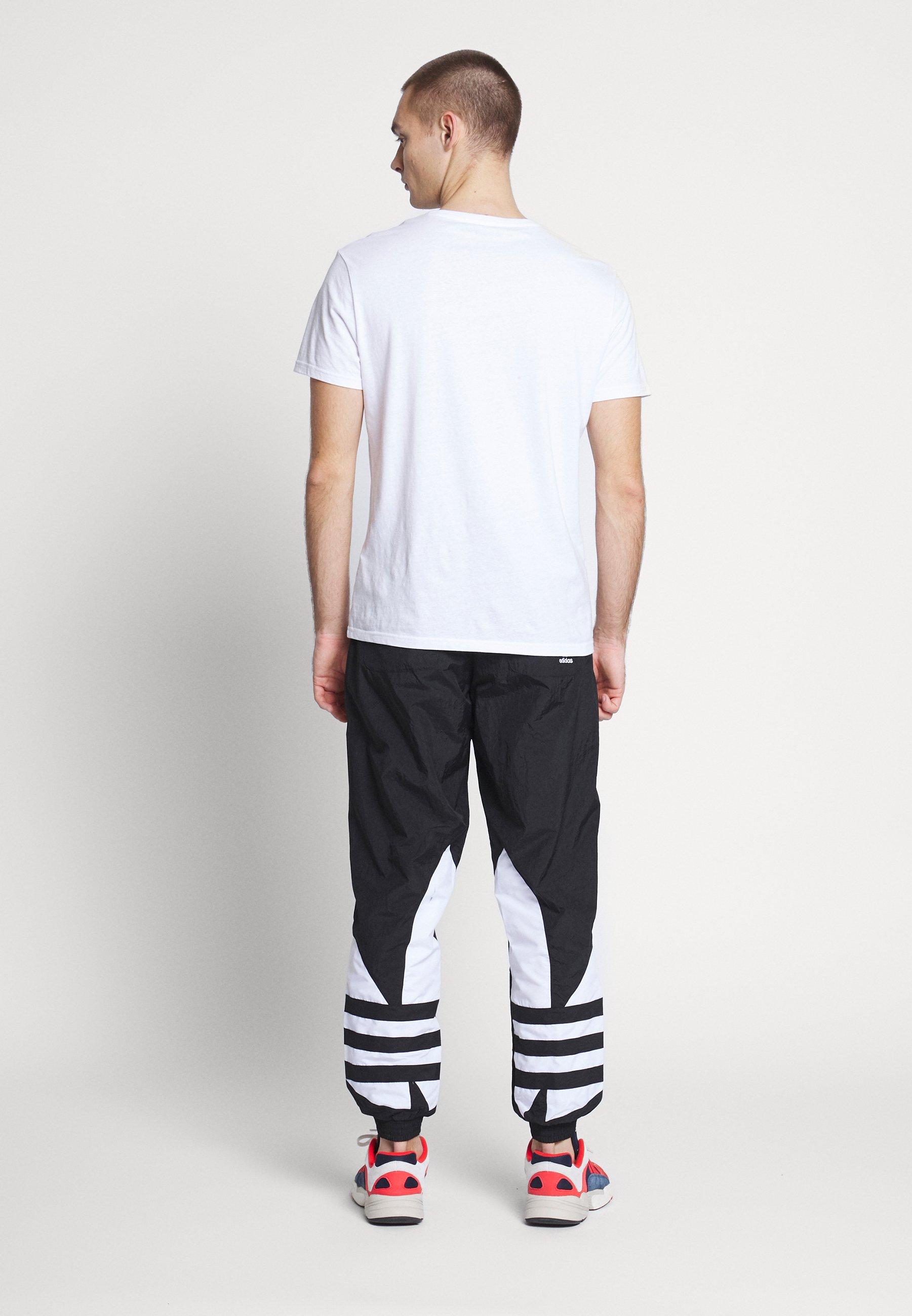 adidas Originals ADICOLOR TREFOIL TRACK PANTS - Pantalon de survêtement - black