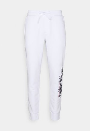 SCRIPT EMBROIDERY UNISEX - Tracksuit bottoms - white