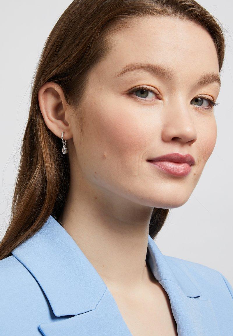 Swarovski - ATTRACT MINI HOOP PEAR - Earrings - silver-coloured