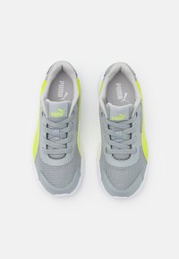 Puma - TAPER AC UNISEX - Neutral running shoes - quarry/energy yellow/gray violet - 3
