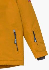 TrollKids - KIDS HOLMENKOLLEN SNOW JACKET PRO - Kurtka snowboardowa - golden yellow/mystic blue - 4