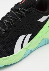 Reebok - NANOFLEX TR - Sports shoes - core black/neon mint - 5