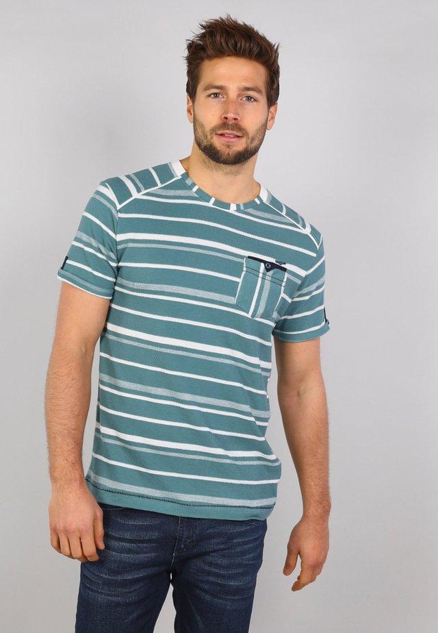 T-shirt med print - kale green