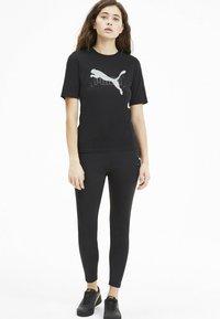 Puma - NU-TILITY - Print T-shirt - black - 1