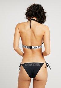 Calvin Klein Swimwear - INTENSE POWER CHEEKY STRING SIDE TIE - Bikini bottoms - black - 2