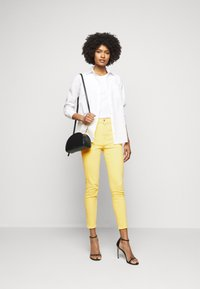 Polo Ralph Lauren - RIELLA - Jeans Skinny Fit - yellow - 1