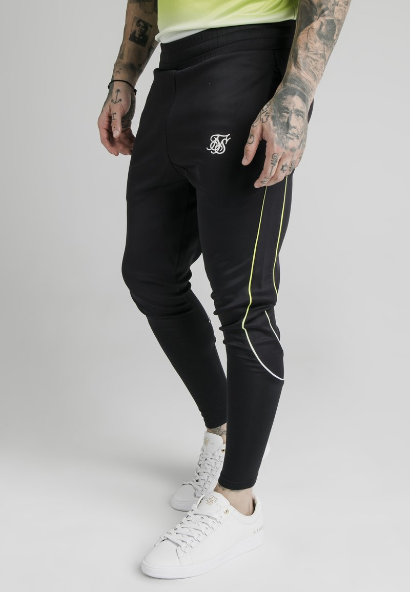 SIKSILK - Tracksuit bottoms - black/white