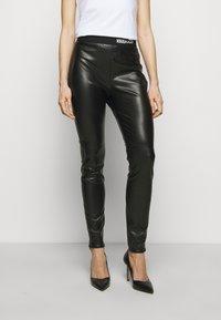 HUGO - HONATI - Leggings - Trousers - black - 0